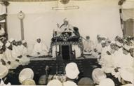 43rd Da�i e Mutlaq Muqaddas Maulaa Saiyedna Yusuf Nooruddin saheb (aq) delivering Wa�az Mubaarak of Moharram ul-Haraam after the old Mosque Masjid-e-Ziyaii was pulled down and the ta�meer of the new mosque began in 1966